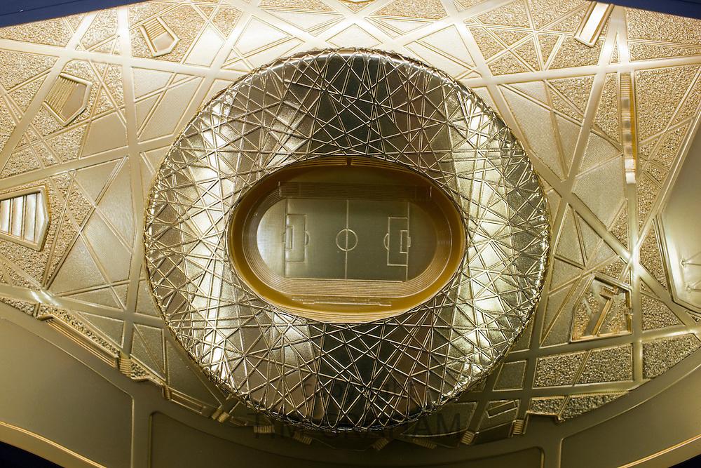 2008 Olympic Games gold Bird's Nest Stadium model in souvenir shop, Wangfujing Street, Beijing, China