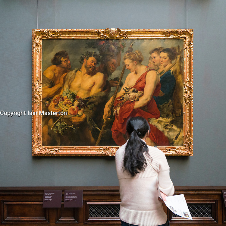 """Visitor looking at  painting """"Diana Returning from the Hunt""""  by Peter Paul Rubens at Gemäldegalerie Alte Meister or Zwinger Museum in Dresden, Germany .Editorial Use Only."""