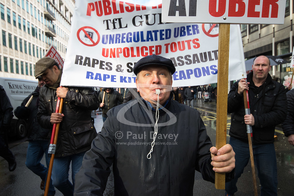 London, March 9th 2016. London cabbies demonstrate and march to the headquarters of Transport For London in Victoria, against the government's continued support for Uber cars which are impacting the trade of Licenced London taxi drivers who complain that passengers are unsafe in the unregulated Uber cars. ©Paul Davey<br /> FOR LICENCING CONTACT: Paul Davey +44 (0) 7966 016 296 paul@pauldaveycreative.co.uk