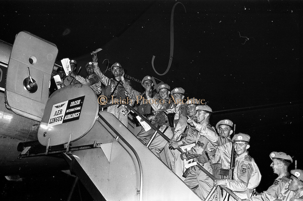 24/10/1962<br /> 10/24/1962<br /> 24 October 1962<br /> 38th Battalion advance party leave for the Congo for United Nations duty. the advance party of the 38th battalion and the 2nd Armoured Squadron left Dublin Airport for the Congo by specially chartered Sabena 707 Boeing jet. The 150 troops would arrive in the Congo the next day. Picture shows some members of the 2nd Armoured Squadron boarding the aircraft.