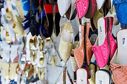 Womens' hoes hanging in market, Fes al Bali medina, Fes, Morocco
