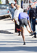 22/11/2015  repro fee.  A group of 25 from Gorta-Self Help Africa travelled to the capital of Ethiopia Addis Ababa for the great Ethiopian run which is Ethiopia's Haile Gebrselassie last race seen here taking off his runners to  run bare foot for the last KM  .  In temperatures in the mid 30 degree heat and 40,000 people and a city at 7,500 feet above sea level, it's no mean feat.   Photo:Andrew Downes <br /> <br /> <br /> <br /> <br /> Pics to be used with Gorta - Self Help Arica images only