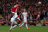 Football - 2021 / 2022 Premier League - Liverpool vs Burnley - Anfield - Saturday 21st August 2021<br /> <br /> <br /> <br /> Liverpool's Harvey Elliott jumps high to beat Burnley's Dwight McNeil to the ball