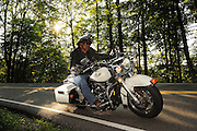 """Motorcycle riding along the """"Tail of the Dragon"""" Highway 129 along the Tennessee/North Carolina border. No model release."""