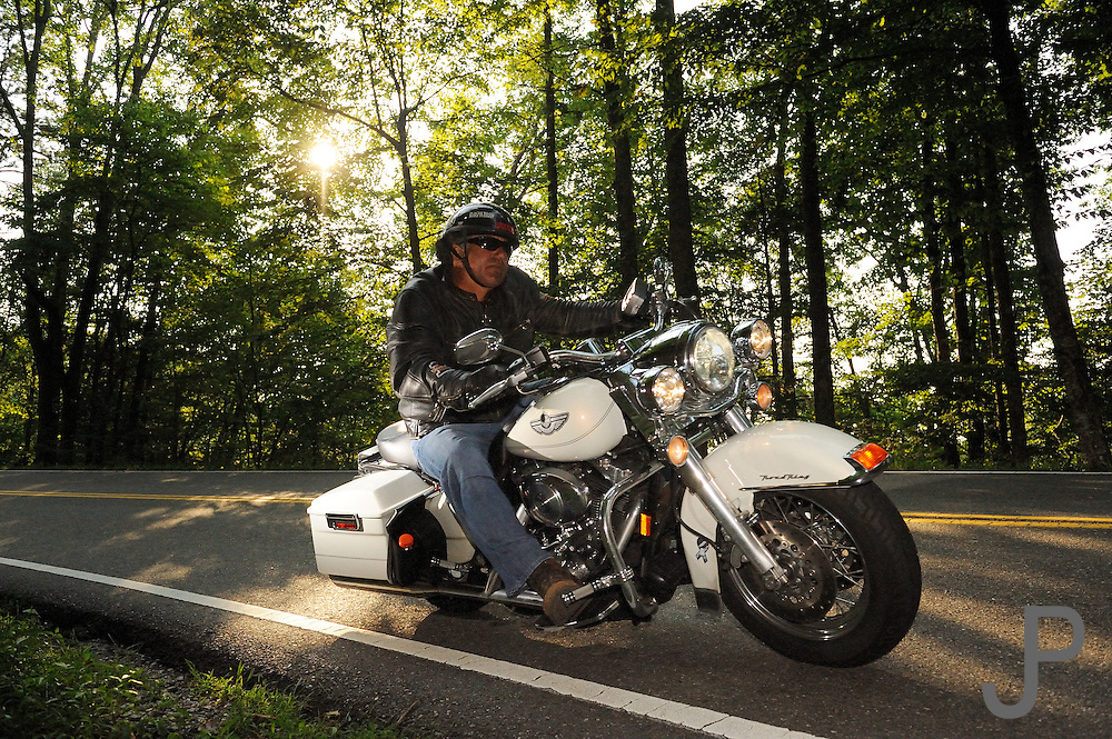 "Motorcycle riding along the ""Tail of the Dragon"" Highway 129 along the Tennessee/North Carolina border. No model release."