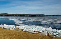 The shoreline at Leslie E. Roberts Beach in Belmont is filled with large ice chunks washed up from the strong winds on Lake Winnisquam this week.  (Karen Bobotas/for the Laconia Daily Sun)