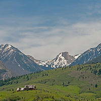 A luxury vacation home sits below Elephant Mountain in the foothills of Montana's Absaroka Mountains, near Livingston. Lion Mountain is on the left and Livingston Peak the right.