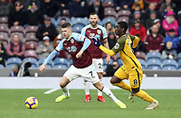 Burnley's Johann Gudmundsson under pressure from Brighton & Hove Albion's Yves Bissouma<br /> <br /> Photographer Rich Linley/CameraSport<br /> <br /> The Premier League - Burnley v Brighton and Hove Albion - Saturday 8th December 2018 - Turf Moor - Burnley<br /> <br /> World Copyright © 2018 CameraSport. All rights reserved. 43 Linden Ave. Countesthorpe. Leicester. England. LE8 5PG - Tel: +44 (0) 116 277 4147 - admin@camerasport.com - www.camerasport.com