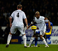 Photo: Jed Wee.<br /> Bolton Wanderers v Tottenham Hotspur. The Barclays Premiership. 07/11/2005.<br /> <br /> Tottenham's Edgar Davids (R) resorts to desperate measures to try to dispossess Bolton's El Hadji Diouf.