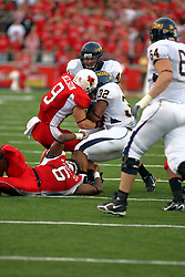 08 September 2007: Tom Nelson and Kye Stewart stop the advance of Paul McKinnis and Nelson works on stripping the ball. The Murray State Racers were defeated by the Illinois State Redbirds 43-17 in a nightcap at Hancock Stadium on the campus of Illinois State University in Normal Illinois.