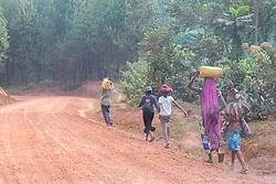 People on Side OF Dirt Road
