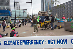 © Licensed to London News Pictures. 30/08/2020. London, UK. Climate protesters are seen at Elephant & Castle roundabout in central London. Extinction Rebellion activists announce disruptions in London and other cities starting on Tuesday. Photo credit: Marcin Nowak/LNP