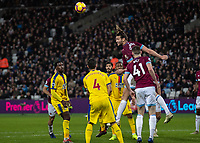 Football - 2018 / 2019 Premier League - West Ham United vs. Crystal Palace<br /> <br /> Andy Carroll (West Ham United) does his defensive work and clears the incoming cross at the London Stadium<br /> <br /> COLORSPORT/DANIEL BEARHAM