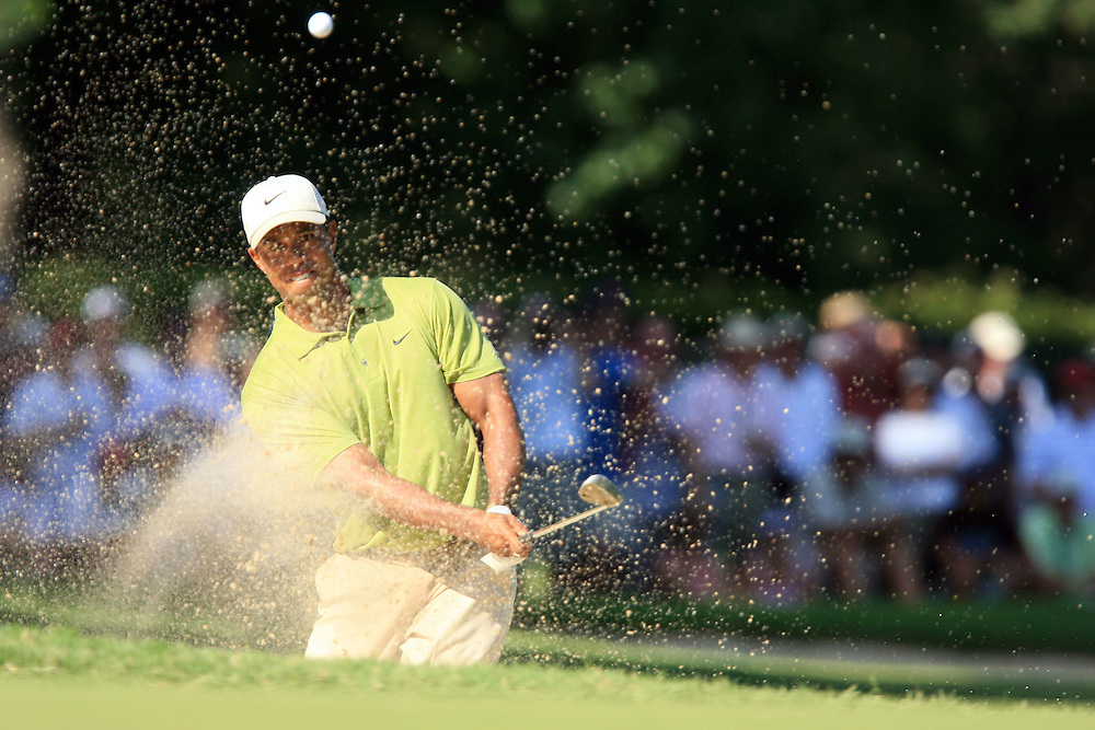 11 August 2007: Tiger Woods blasts out of the green side bunker on the 13th hole during the third round of the 89th PGA Championship at Southern Hills Country Club in Tulsa, OK.