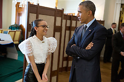 President Barack Obama talks with National Student Poet Madeline LaCesne in the Old Family Dining Room before she introduces him during the National Poetry Month Celebration event at the White House, April 17, 2015. (Official White House Photo by Pete Souza)<br /> <br /> This official White House photograph is being made available only for publication by news organizations and/or for personal use printing by the subject(s) of the photograph. The photograph may not be manipulated in any way and may not be used in commercial or political materials, advertisements, emails, products, promotions that in any way suggests approval or endorsement of the President, the First Family, or the White House.