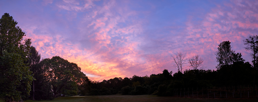 Backyard Dawn Panorama. Early Autumn Morning Colorful Clouds. Composite of seven images taken with a Leica CL camera and 18 mm f/2.8 lens (ISO 200, 18 mm, f/2.8, 1/125 sec). Raw images processed with Capture One Pro, and AutoPano Giga Pro.