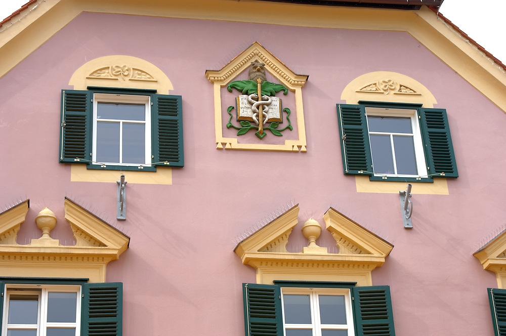 Baroque window and apocathary crest on a house Hartberg Austria Visit our PHOTO COLLECTIONS OF SLOVANIAN  HISTOIC PLACES for more photos to download or buy as wall art prints https://funkystock.photoshelter.com/gallery-collection/Pictures-Images-of-Slovenia-Photos-of-Slovenian-Historic-Landmark-Sites/C0000_BlKhcYWnT4Sites/C0000qxA2zGFjd_k