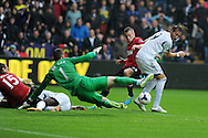 Swansea city's Michu is denied by Man Utd keeper David de Gea. Barclays Premier league, Swansea city v Manchester Utd in Swansea, South Wales on Saturday 17th August 2013. pic by Andrew Orchard ,Andrew Orchard sports photography,