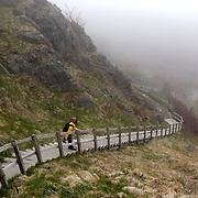 Haruka Kozen (cq), who is visiting from Tokyo, starts down the steps to a lower part of the cliffs at Signal Hill in St. John's, Newfoundland and Labrador, Canada, on Monday, June 3, 2019. THE BLADE/KURT STEISS <br /> MAG NewfoundlandXX