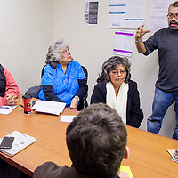 Jose Olivas, right, answers questions during an interview at Department of Workforce Solutions in Gallup Thursday.