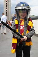 A young Bradford City fan poses for a photo wearing Police attire outside the stadium before the game. EFL Skybet football league one play off final match, Bradford city v Millwall at Wembley Stadium in London on Saturday 20th May 2017.<br /> pic by Steffan Bowen,  Andrew Orchard sports photography.
