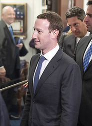 Surrounded by staff and security, Mark Zuckerberg, Co-Founder and Chief Executive Officer of Facebook, walks out of United States Senator Dianne Feinstein's (Democrat of California) office as he makes the rounds on Capitol Hill prior to giving testimony before Congress on Tuesday and Wednesday on Monday, April 9, 2018 in Washington, DC, USA. Photo by Ron Sachs/CNP/ABACAPRESS.COM