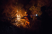 Member of Conservation (Fire) Camps, set the bushes on fire before the wildfire comes down to stop the wildfire from growing. Conservation (Fire) Camps is the program that provides prisonors to the emergencies for helping firefighters. On Thursday, December 7th, 2017 at Camp Ramah in California in Ojai, California. (Photo by Yuki Iwamura)