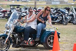 Jayne Zaleski with Laura Mastropolo in the Harley-Davidson HOG field games at the Full Throttle Saloon during the Sturgis Motorcycle Rally. SD, USA. Thursday, August 12, 2021. Photography ©2021 Michael Lichter.