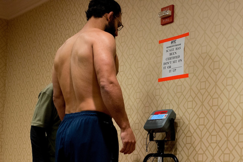 Johny Hendricks weighs-in at 190.8 in an unofficial medical check prior to UFC 171 in Dallas, Texas on March 11, 2014.