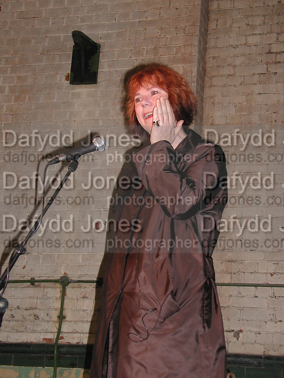 Director Jules Wright holding back tears during speech. Opening of the Wapping Project. Wapping Hydrolic Power Station. 12/10/00. © Copyright Photograph by Dafydd Jones 66 Stockwell Park Rd. London SW9 0DA Tel 020 7733 0108 www.dafjones.com