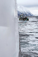 On the ship Sula, Moere coastline, Norway.Model release by photographer