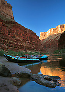 Rafts at dawn on the Colorado River in the interior of the Grand Canyon