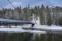 Suspension Bridge over Metho River in winter, North Cascades Washington
