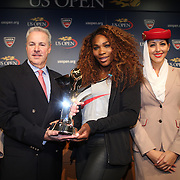 2013 Emirates Airline US Open Series Champions Serena Williams, USA, presented with her trophy from David Brewer, USTA Chief Professional Tennis Officer and US Open Tournament Director during a press conference at the US Open. Flushing. New York, USA. 24th August 2013. Photo Tim Clayton