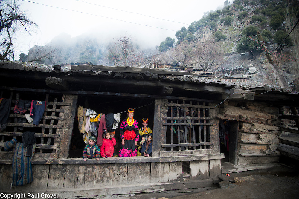 Bumburet, Chitral District,Pakistan.Pic Shows Kalash in their home village in the valley of Bumburet making some traditional clothing