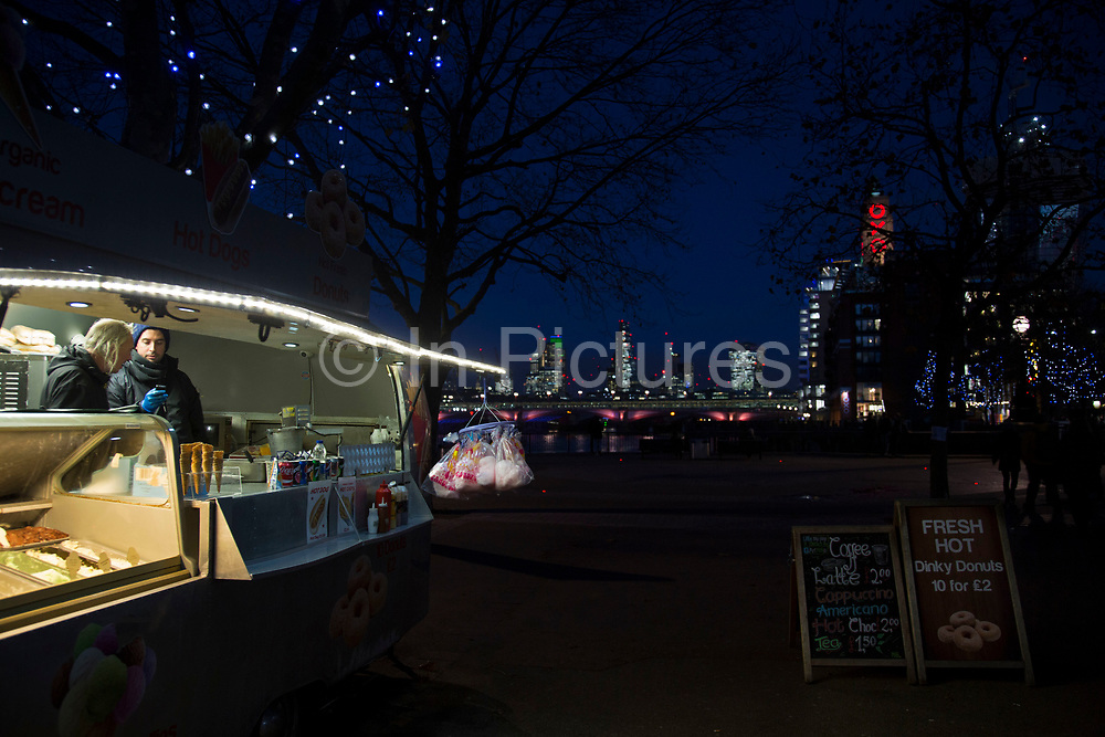 Airstream van burger food stall on the riverside walkway as dusk turns to evening on the Southbank, London, United Kingdom. The South Bank is a significant arts and entertainment district, and home to an endless list of activities for Londoners, visitors and tourists alike. (photo by Mike Kemp/In Pictures via Getty Images)
