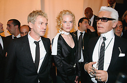 Australian director Baz Luhrmann, German stylist Karl Lagerfeld and Australian actress Nicole Kidman during Lagerfeld's Spring/Summer 2005 Ready-to-Wear collection presentation for the French fashion house Chanel at the Carrousel du Louvre in Paris, France, on October 8, 2004. Photo by Klein-Nebinger/ABACA.