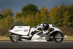 © Licensed to London News Pictures. 16/10/2018. York UK. Graham Sykes test runs his steam-powered rocket bike called Force of Nature at Elvington airfield today. Graham a precision engineer has spent six years building the bike, a 60 kW bio-fuel burner is attached to the bike to heat 50 litres of water in the pressure vessel to 250°C and 40 bar pressure via a flame holder tube running through the centre. The bike is capable of 600kfg of peak thrust over 6 seconds allowing it to reach over 200 mph in a quarter mile. Photo credit: Andrew McCaren/LNP