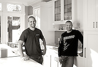 Thomas Philips Woodworking, owned by Eric Gummer and Derek Paas hang out in a newly installed kitchen the company built for a Victorian home built in the early 1920s.