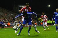 Football - Europa League - Stoke City vs. Dynamo Kiev<br /> Kiev's Betao fends off Stoke's Ryan Shotton at the Britannia Stadium