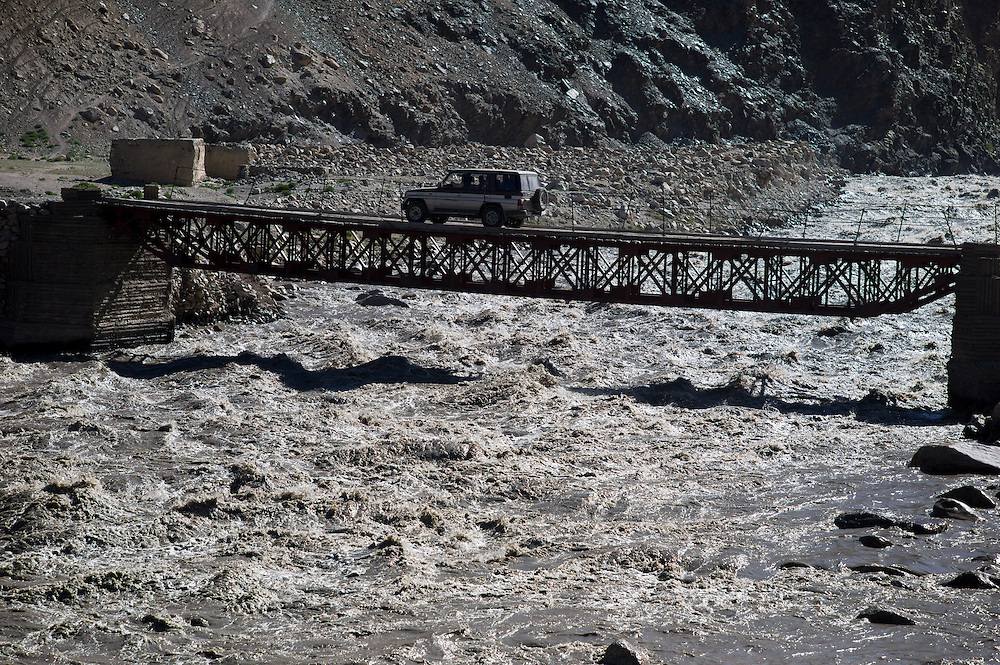 One of our vehicles crosses one of the few road bridges in the Wakhan on the drive to Sarhad.