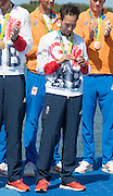 "Rio de Janeiro. BRAZIL. Cox Phelan HILL, checks his medal.  2016 Olympic Rowing Regatta. Lagoa Stadium,<br /> Copacabana,  ""Olympic Summer Games""<br /> Rodrigo de Freitas Lagoon, Lagoa.   Saturday  13/08/2016 <br /> <br /> [Mandatory Credit; Peter SPURRIER/Intersport Images]"