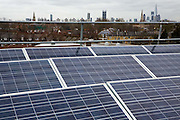 Solar photo voltaic (PV) panels on the roof of Elmore House, a community owned solar installation in Loughborough estate in Brixton, London United Kingdom.  Brixton Energy Solar has installed several hundred square metres of solar panels on the roof of Elmore House in the Loughborough Estate in Brixton. Set up by Re-powering London, empower London communities to create their own renewable energy projects. (photo by Andrew Aitchison / In pictures via Getty Images)