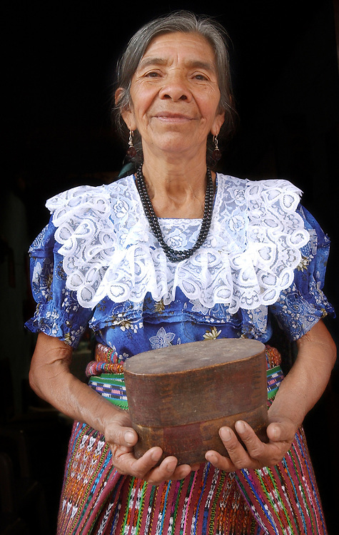 8/5/03  Photo by Mara Lavitt--Ana & box<br /> #0446<br /> San Juan la Laguna midwife Ana Toc de Ramos age 63 holds the wooden box within which can be found the remnants of her amniotic membrane which denotes her special calling to midwifery.
