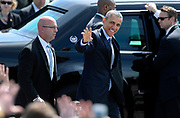 President Barack Obama waves to a crowd upon his arrival at Groton-New London Airport, Wednesday, May 20, 2015, in Groton, Conn., before giving the commencement address at the Coast Guard Academy.   (AP Photo/Jessica Hill)