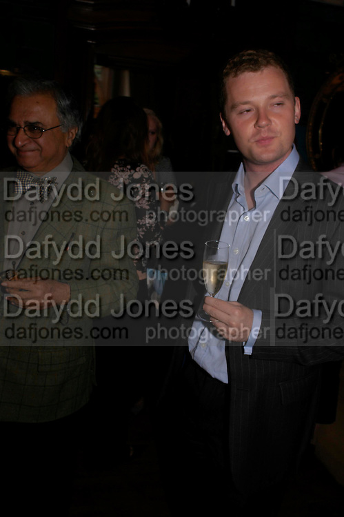 Deepak Lal and Neil O'Brien. No Campaign's Summer Party. A celebration of the 'Non' and 'Nee' votes in the European referendum in France and The Netherlands held at The Peacock House, 8 Addison Road, London. 5 July 2005. ONE TIME USE ONLY - DO NOT ARCHIVE  © Copyright Photograph by Dafydd Jones 66 Stockwell Park Rd. London SW9 0DA Tel 020 7733 0108 www.dafjones.com