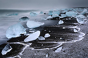 Hail on the beach at dusk at Jökulsárlón in South-East Iceland. As the waves came in the hail eventually got washed away.