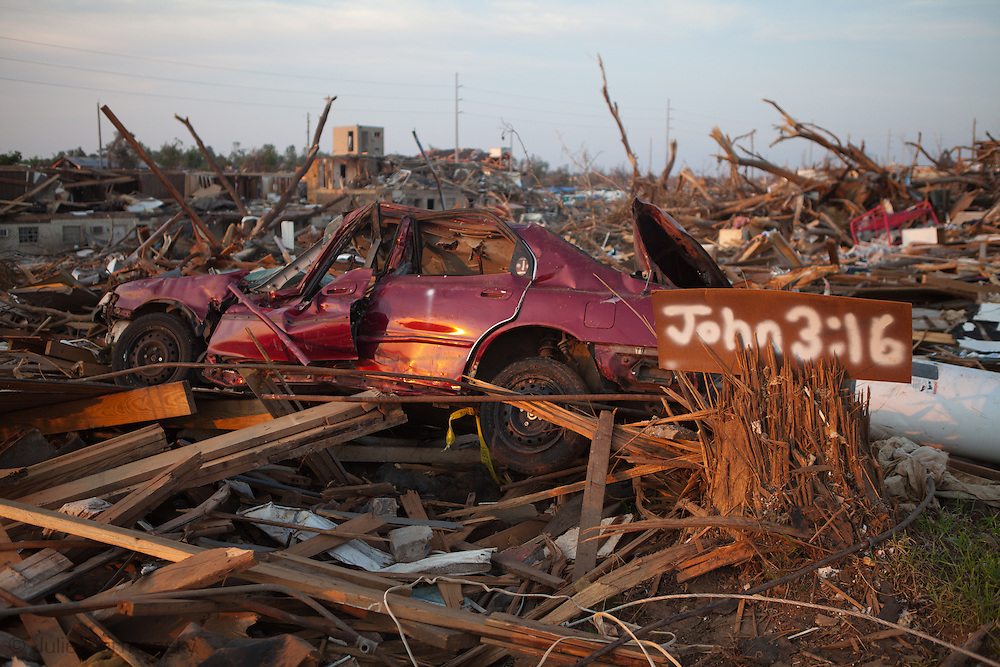 Destoryed car in Tuscaloosa Alabama after being hit by a tornado with a message from the bible next to it . Tuscaloosa was hit by  F-4 and  possibly  F-5 tornados that were part of a storm  of an estimated 300 that struck Alabama and the neighboring states on April 27th , 2011.