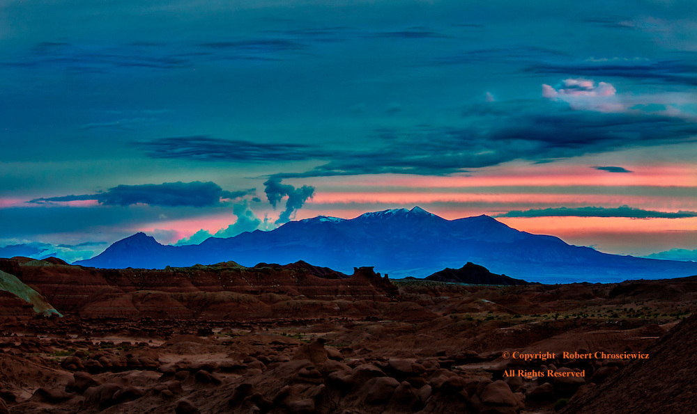 Silhouette Blue: A subtle yet spectacular sunset of a distant silhouetted mountain range cast in blue, as seen from the other worldly first valley  in Goblin State Park, Utah USA.