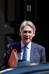 © Licensed to London News Pictures. 21/06/2017. London, UK. The Chancellor of The Exchequer Philip Hammond leaves 11 Downing Street on his way to the Queen's Speech for the State Opening of Parliament. Photo credit: Rob Pinney/LNP
